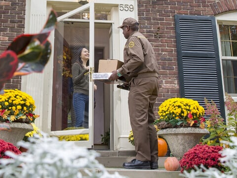 UPS driver dropping off parcel