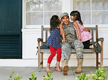Veteran in uniform with family members