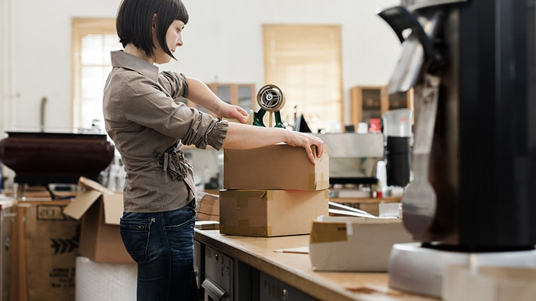 Woman preparing packages for shipping